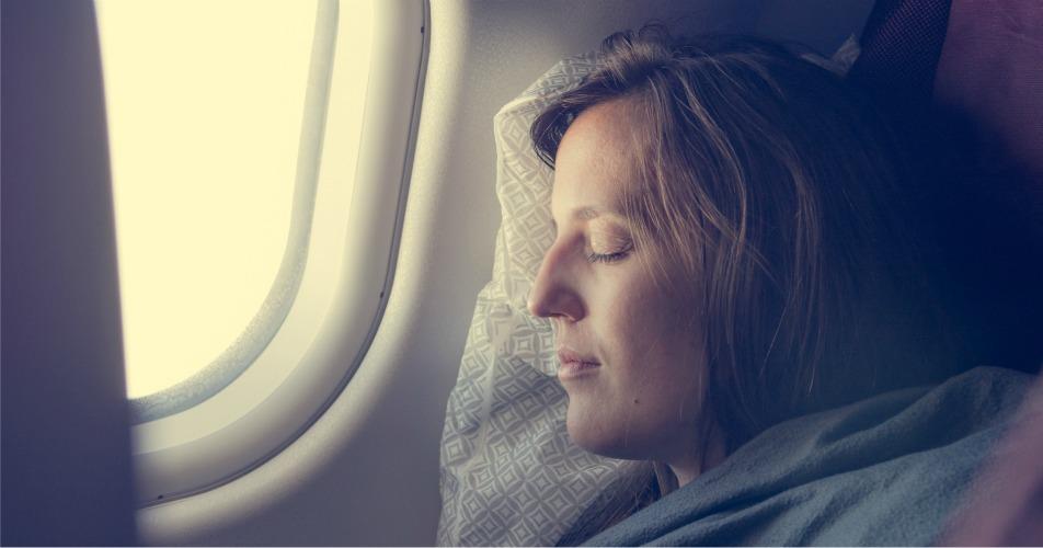 Female sleeping on plane