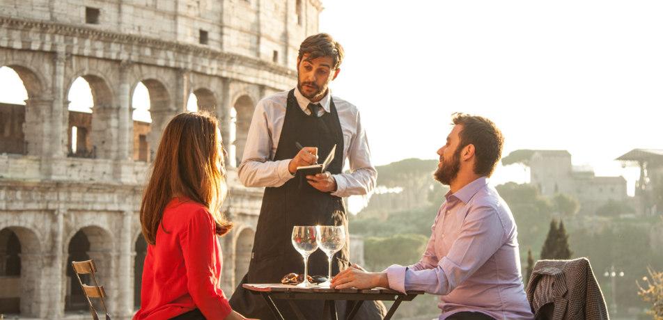 Travelers ordering food in Rome