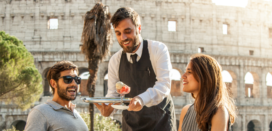 Couple and their waiter in Rome