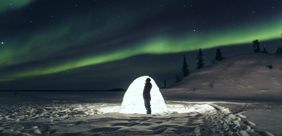 Northern lights above an igloo