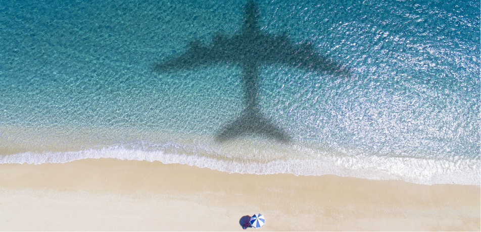 Plane flying over a beach