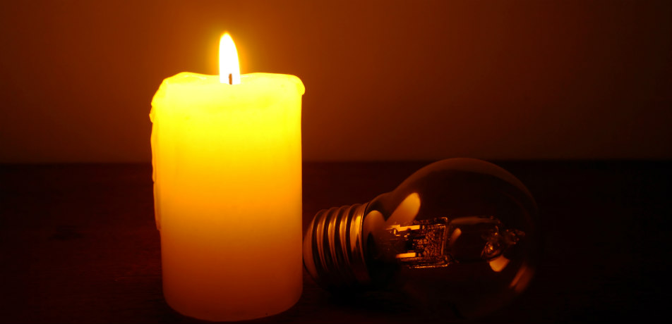 Candle providing light during a power outage
