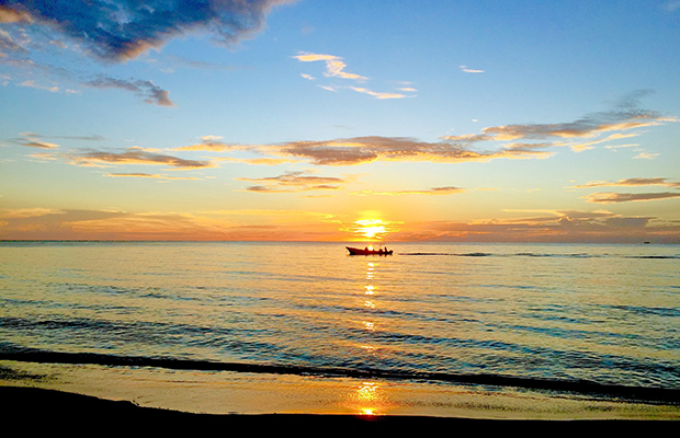Fishing boat returning to Big Corn Island, Nicaragua, at sunset