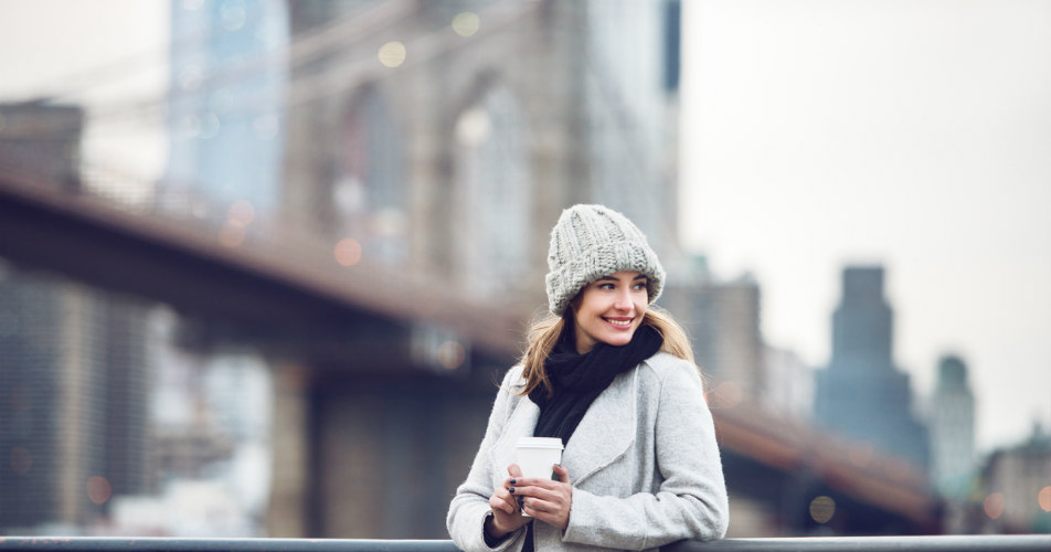 Woman holding coffee cup in NYC