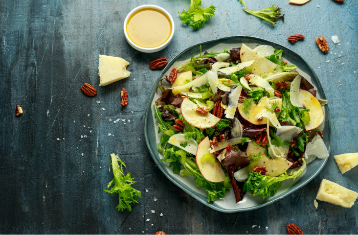 Healthy salad with dressing on the side