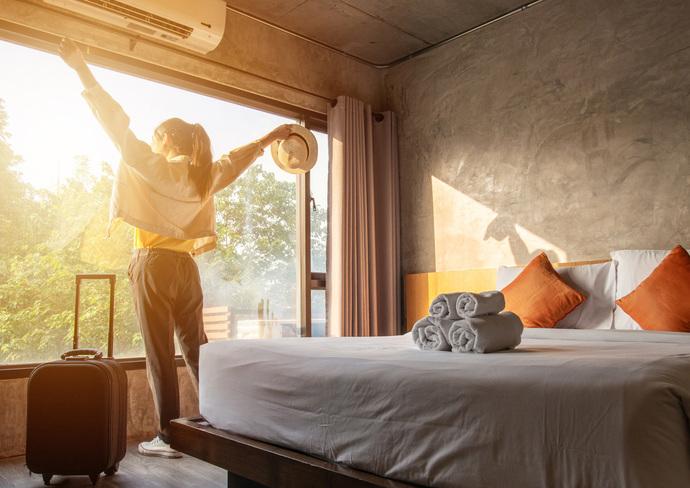 Traveler in hotel room