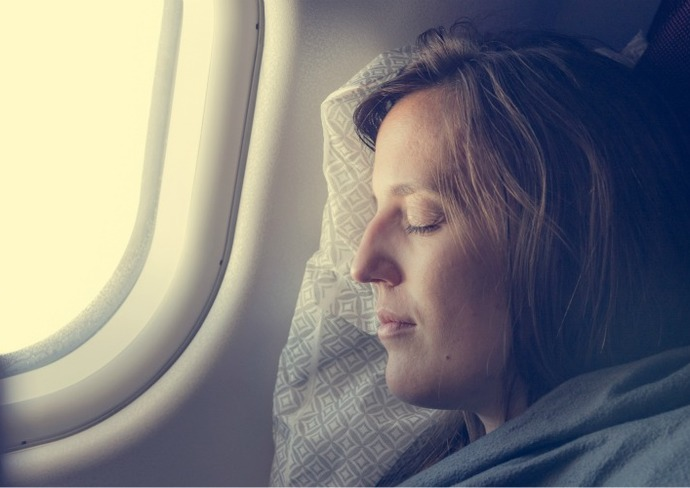 Female sleeping on plane